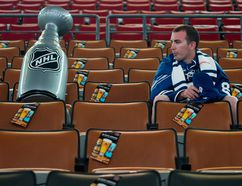 A fan sits in the empty seats near a blow-up Stanley Cup before the start of the Toronto Maple Leafs and the Boston Bruins fourth game of their first round playoff series at Air Canada Centre on May 8, 2013. (Tyler Anderson/National Post)