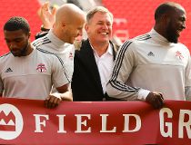 TFC player Michael Bradley and former MLSE CEO Tim Leiweke share a laugh as TFC held its official grand opening of BMO Field in preparation for their 2015 home opener vs, the Houston Dynamo in Toronto, Ont. on Friday May 8, 2015. Jack Boland/Toronto Sun/P
