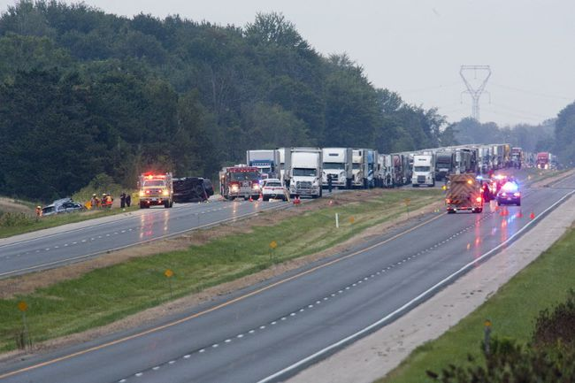 A woman and a child were killed after a pickup truck crossed the median and collided head-on with a vehicle on Highway 401 between Iona Road and Currie Road in London, Ont. on Tuesday August 29, 2017. (DEREK RUTTAN, The London Free Press)