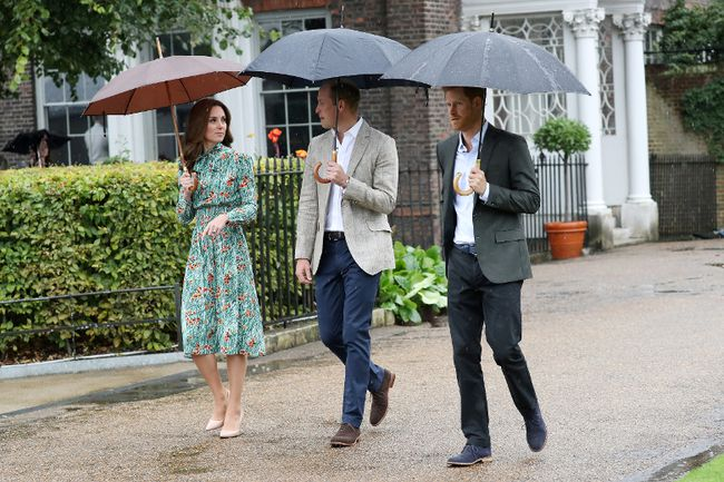 Prince William, Catherine, Duchess of Cambridge, and Prince Harry visit The Sunken Garden memorial to their late mother Princess Diana on the eve of the 20th anniversary of her death. (Photo by Chris Jackson/Getty Images)