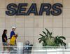 In this file photo, shoppers walk by the sign at a Sears store in Pittsburgh, Pennsylvania. (AP Photo/Gene J. Puskar)