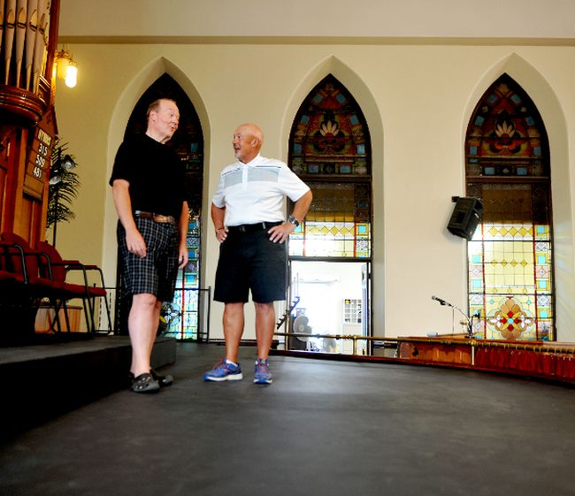 Chris Coyea, left, and David Dargie share a laugh on the newly completed stage at St. John's United Church on Thursday. (RONALD ZAJAC/The Recorder and Times)