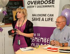 Kingston, Frontenac, Lennox & Addington Public Health nurse Rhonda Lovell holds a Naloxone kit as Medical Officer of Health Dr. Kieran Moore looks on during a news conference to mark International Overdose Day at the Street Health Centre in Kingston on Thursday. (Ian MacAlpine/The Whig-Standard)