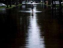 A woman walks down a flooded road during the aftermath of Hurricane Harvey in Houston, Texas. (GETTY IMAGES/PHOTO)