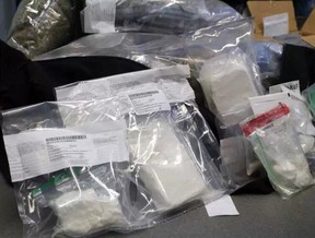 Stony Plain/Spruce Grove/Enoch RCMP seized nearly $700,000 worth of drugs, including carfentanil, two guns, $45,000 in cash, a silver bar and gold coins from a residence in west Edmonton on Friday, Aug. 25, 2017.  JESSE COLE / POSTMEDIA