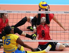 Team Canada's captain Jolan Wong, right, takes on Team Rwanda during sitting volleyball at the Rio Paralympics in Rio De Janerio, Brazil in 2016. POSTMEDIA FILE PHOTO