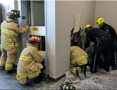 Ottawa Fire Services rescue specialists cut holes in an elevator shaft to free a 38-year-old technician trapped underneath the device. He was taken to hospital in serious but stable condition with crush-type injuries. (Scott Stilborn, Ottawa Fire)