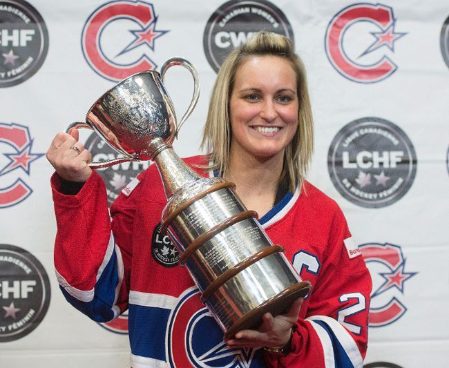 Marie-Philip Poulin, captain of Les Canadiennes de Montreal, the Canadian Women's Hockey League champions, poses for photos with the Clarkson Cup after a news conference, Wednesday, March 8, 2017 in Brossard, Que. (THE CANADIAN PRESS/Ryan Remiorz)