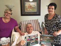 AMY TUCKER HIGH RIVER TIMES/ POSTMEDIA NETWORK. Amy Tucker Postmedia Network Daughter, Jan Loree, and wife Lynne Sharp (right) visit Bill Sharp in the Foothills Country Hospice Aug. 16 for an interview with the Times about Bill's beloved train model.