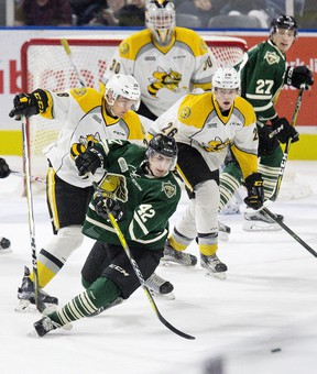 DEREK RUTTAN/Postmedia Network London Knights' Jacob Golden falls with help from Sarnia Sting defenceman Kelton Hatcher's stick during the first period of an OHL pre-season game Friday at Budweiser Gardens  in London. Also pictured are Colton Kammerer (26) and Aidan Hughes (30) of the Sting and Robert Thomas (27) of the Knights.