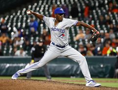 Toronto Blue Jays relief pitcher Carlos Ramirez throws to the Baltimore Orioles during the 10th inning of a baseball game in Baltimore, Friday, Sept. 1, 2017. It was his major league debut. (AP Photo/Patrick Semansky)