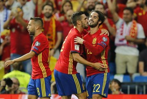 Spain's Isco, right, celebrates after scoring the opening goal during the World Cup qualifying match at the Santiago Bernabeu Stadium in Madrid, Saturday Sept. 2, 2017. (AP Photo/Paul White)
