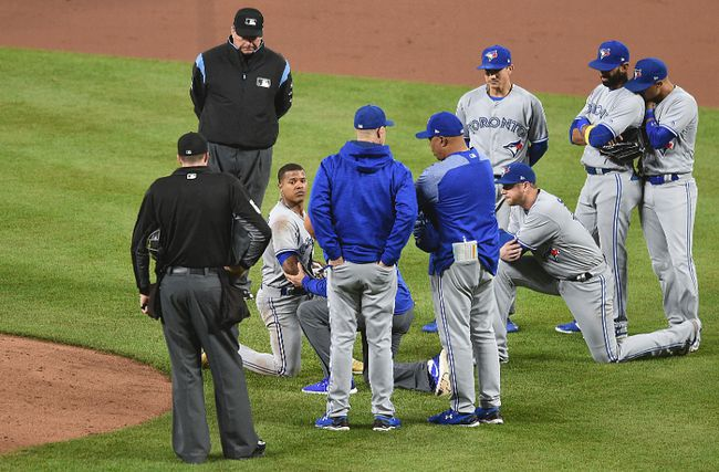 Teammates surround Blue Jays pitcher Marcus Stroman, facing camera, after he was hit by a line drive during a game against the Baltimore Orioles Saturday, Sept. 2, 2017, in Baltimore. (AP Photo/Gail Burton)