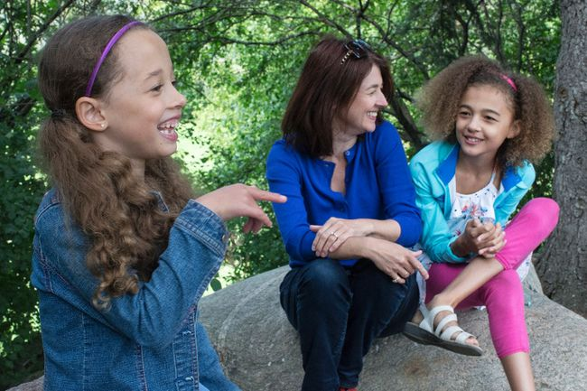 Patty Sullivan sits with her daughters Aliyah, 6 and Veronica, 10, near their Toronto home on Friday September 1, 2017. THE CANADIAN PRESS/Chris Young