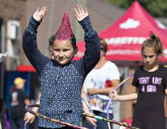Eight-year-old Mariah Toth of St. Williams competes in a Hula Hoop contest on Saturday during Bayfest in Port Rowan. Toth placed third in the contest, and in a Wacky Hair contest earlier in the day. Brian Thompson/Postmedia Network
