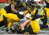 Argonauts' running back Martese Jackson gets lost in a pile of Hamilton Tiger-Cats after gaining a few yards in Hamilton last night. (The Canadian Press)