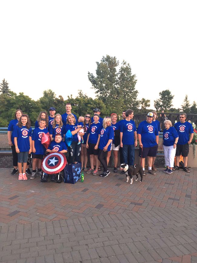 Sporting Captain America logos, local residents gathered at Broadmoor Lake Park in support of 10-year-old Zachary Murri, raising money for treatment that could help save his life. 