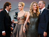 From left, actors Javier Bardem, Jennifer Lawrence, Michelle Pfeiffer and director Darren Aronofski pose for photographers at the premiere of the film 'mother!' at the 74th edition of the Venice Film Festival in Venice, Italy, Tuesday, Sept. 5, 2017. (AP Photo/Domenico Stinellis
