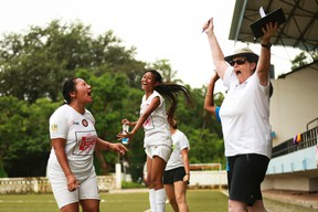 Londoner Linda Whitehead celebrates with a couple female soccer players in Goa, India. Whitehead recently participated in a combination soccer/women's rights festival organized by German NGO Discover Football. (Alexa Vachon/Special to Postmedia News/Discover Football)