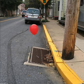 The Lititz police department on Tuesday posted on photos of red balloons a prankster tied to a pair of sewer grates. (Lititz Borough Police Department/Facebook)