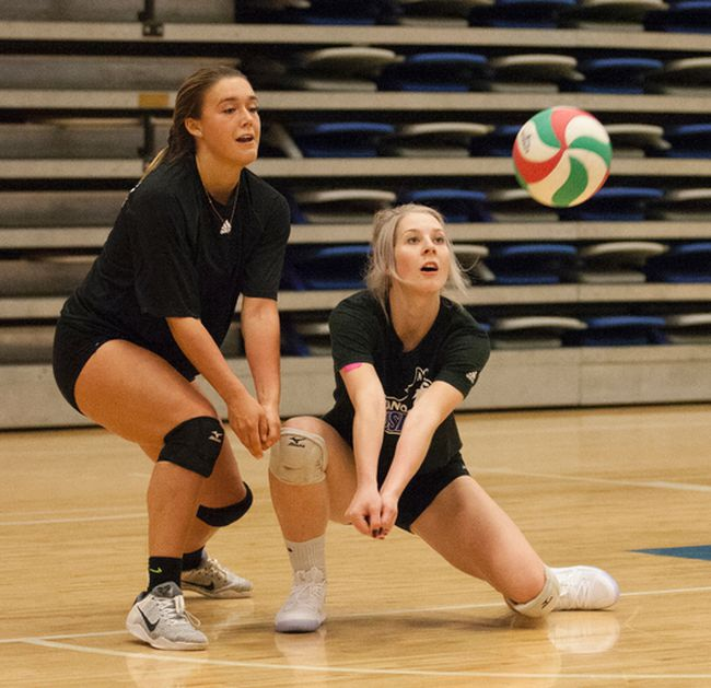 Danya Nieman, right, crouches down to receive a serve Thursday at the Syncrude Sport and Wellness Centre. Nieman is one of the returning Huskies players hoping to guide the team to the post-season and beyond under the leadership of new head coach Nic Davies. Robert Murray/Fort McMurray Today/Postmedia Network
