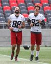 Redblacks receivers Brad Sinopoli (left) and Greg Ellingson share a laugh during practice at TD Place on Tuesday.. Ellingson needs 967 yards in the final seven games to reach 2,000 yards. (Tony Caldwell/Ottawa Sun)