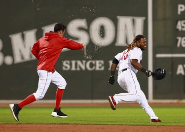 Joe Kelly #56 chases Hanley Ramirez #13 of the Boston Red Sox after he hits an RBI single in the bottom of the nineteenth inning to win the game against the Toronto Blue Jays at Fenway Park on September 5, 2017 in Boston, Massachusetts.  (Photo by Omar Rawlings/Getty Images)