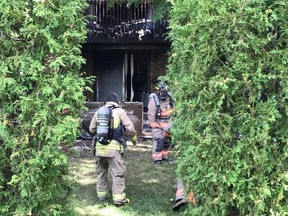 Firefighters at the scene of a fatal townhome fire at Copenhagen Rd. at Derry Rd. W. in Mississauga on Wednesday, Sept. 6, 2017. (Pascal Marchand/Special to the Toronto Sun)