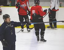 Central Plains head coach Brad Gnidziejko directs traffic during camp Tuesday night at Portage Mutual Arena in Portage la Prairie. (Brian Oliver/The Graphic)