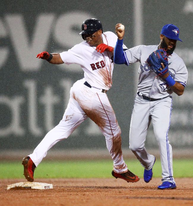 Rafael Devers of the Boston Red Sox collides with Richard Urena of the Toronto Blue Jays at second base during the fourth inning at Fenway Park on Sept. 6, 2017. (Maddie Meyer/Getty Images)