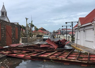 """A picture released on the Facebook account of Kevin Barrallon on September 7, 2017  shows wreckages in a street of Gustavia on the French overseas collectivity of Saint-Barthelemy in the Caribbean following hurricane Irma. Hurricane Irma sowed a trail of deadly devastation through the Caribbean, reducing to rubble the tropical islands of Barbuda and St Martin and claiming at least seven lives. / AFP PHOTO / FACEBOOK / Kevin Barrallon / RESTRICTED TO EDITORIAL USE - MANDATORY CREDIT """"AFP PHOTO / FACEBOOK / KEVIN BARRALLON"""" - NO MARKETING NO ADVERTISING CAMPAIGNS - DISTRIBUTED AS A SERVICE TO CLIENTS  KEVIN BARRALLON/AFP/Getty Images"""
