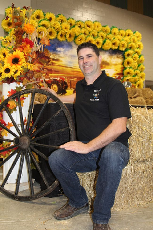 Rock Whissel, president of the Porcupine District Agricultural Society, takes a break by the stage set up in the Mountjoy Arena in preparation for last year's Timmins Fall Fair. The arena is the host site of the new Mountjoy Farmers' Market which will run every Saturday morning throughout the summer.