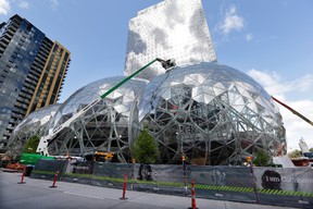 Construction continued in April on three large, glass-covered domes as part of an expansion of the Amazon.com campus in downtown Seattle. (AP PHOTO)
