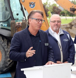 Perth East Coun. Jerry Smith, right, looks on as Union Gas district manager Steven Jelich speaks during a press conference on the installation of a new pipeline on Thursday, Sept. 7, 2017 in Milverton, Ont. (Terry Bridge/Stratford Beacon Herald)