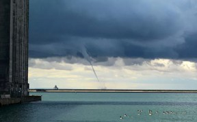 A waterspout makes its way east on Lake Erie toward the foghorn Thursday September 7, 2017 in Port Colborne, ON. Waterspouts and funnel clouds over the lake were reported in Port Colborne and Wainfleet Thursday morning. More are expected to form Friday. Dave Johnson/Postmedia