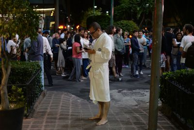 People gather on a street in downtown Mexico City during an earthquake on Sept. 7, 2017.  (LUIS PEREZ/AFP/Getty Images)