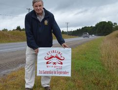 Terry Vollum/For The Intelligencer Stirling Rotarian, Bill Vaughan gets set to plant one of the many roadside signs advertising this year's Stirling Water Buffalo Festival. The event runs from 11 a.m. to 4 p.m. Saturday, Sept. 16 in the village and admission is free. The festival is organized and run jointly by Stirling Rotary and the Stirling & District Lions club.