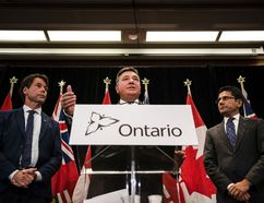 Minister of Finance, Charles Sousa, centre, Attorney General, Yasir Naqvi, right, and Minister of Health and Long-Term Care, Eric Hoskins speak during a press conference where they detailed Ontario's solution for recreational marijuana sales, in Toronto on Friday, September 8, 2017. THE CANADIAN PRESS/Christopher Katsarov