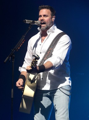 In this Jan. 17, 2013 file photo, Troy Gentry of the Country Music duo Montgomery Gentry performs on the Rebels On The Run Tour in Lancaster, Pa. Gentry, one half of the award-winning country music duo Montgomery Gentry, died Friday, Sept. 8, 2017, in a helicopter crash, according to a statement from the band's website. He was 50. The group was supposed to perform Friday at the Flying W Airport & Resort in Medford, N.J. (Photo by Owen Sweeney/Invision/AP, File)