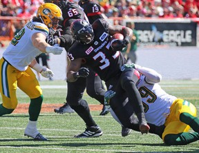Calgary Stampeders running back Jerome Messam runs the all against the Edmonton Eskimos during the first half of the Labour Day Classic at McMahon Stadium, Monday September 4, 2017.