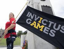 Liz Steeves kicked off the Invictus Games ceremonial flag tour by standing by the B.C. Legislature Cenotaphe in August. (Contributed photo)