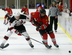 Brockville Braves Fred Allaire trying to beat Kemptville 73s Neal Samanski to the puck during Friday's game at the Memorial Centre. (Jonathon Brodie/The Recorder and Times)