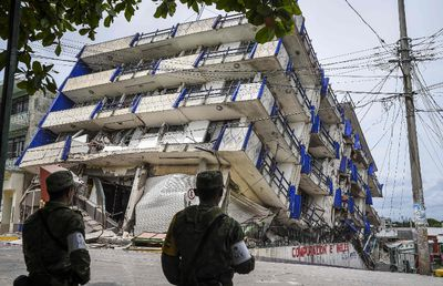 Soldiers stand guard a few metres away from the Sensacion hotel which collapsed with the powerful earthquake that struck Mexico overnight, in Matias Romero, Oaxaca State, on Sept. 8, 2017. (VICTORIA RAZO/AFP/Getty Images)
