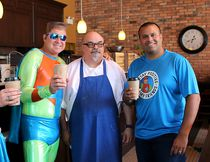 Joe Robertson, owner of Cup of Joe, coffee shop, took a quick break from work for this picture with OptiWoman, Capt. Positive and Aaron Rodrigues, Chatham Daily News media sales manager, in Chatham, Ont. on Saturday September 9, 2017. Ellwood Shreve/Chatham Daily News/Postmedia Network