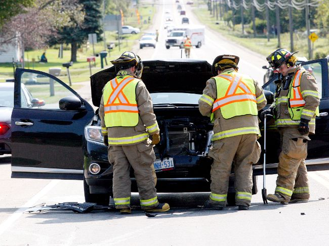 Elizabethtown-Kitley firefighters secure a sport utility vehicle involved in a collision on County Road 29 on Sunday morning. One person suffered minor injuries. (RONALD ZAJAC/The Recorder and Times)