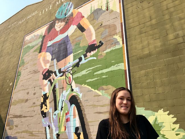Lea McCroy, 17, poses for a photo in front of a Canmore mural in memory of her mom, Isabelle Dube, who was killed in a grizzly bear attack in June 2005, in Canmore, Alta., on Wednesday, August 30, 2017. THE CANADIAN PRESS/Colette Derwoiz