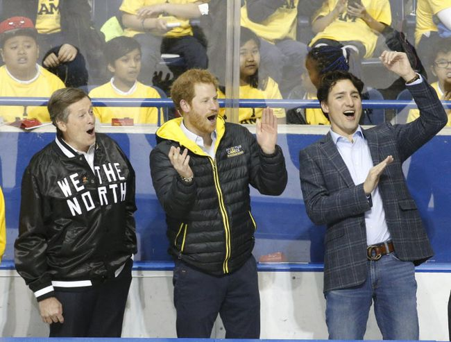 Toronto Mayor John Tory, Prince Harry and Prime Minister Justin Trudeau are pictured in May, 2017, as they celebrate a goal at a demonstration game at Ryerson University of sledge hockey which will be a sport in the 2017 Invictus Games. (MICHAEL PEAKE, Toronto Sun)