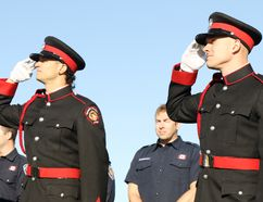 Chris Storeshaw (left), Torren Freeman and Matt Rennie, members of the Grande Prairie Fire Department honour guard, salute as flags at the Westgate Firehall are lowered to half-mast to mark Firefighters National Memorial Day on Sunday September 10, 2017 in Grande Prairie, Alta. Kevin Hampson/Grande Prairie Daily Herald-Tribune/Postmedia Network