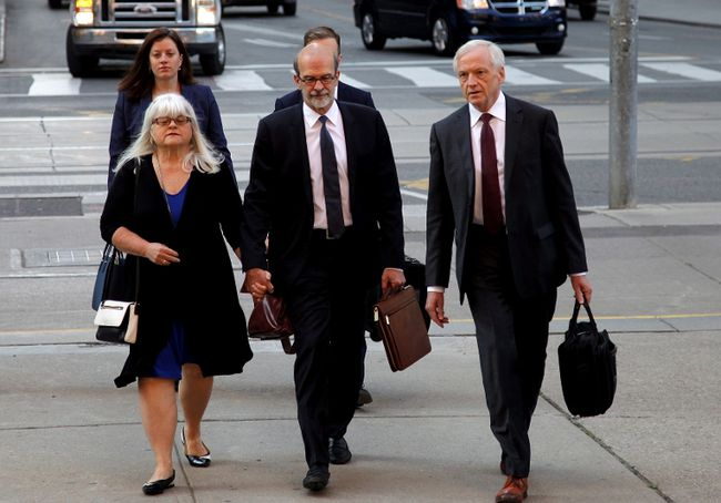 David Livingston (centre), chief of staff to former Ontario premier Dalton McGuinty, arrives at court in Toronto with his lawyer Brian Gover (right) on Monday, Sept. 11, 2017. Livingston and his deputy Laura Miller face allegations they illegally destroyed documents related to a government decision to scrap two gas plants ahead of the 2011 provincial election. (THE CANADIAN PRESS)