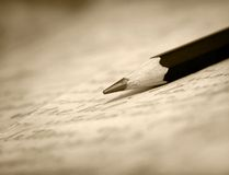 In this stock photo, a pencil sits on pages from a book of poetry. (Getty Images)